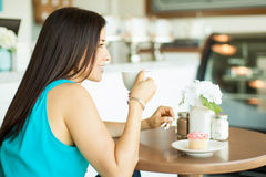 Happy girl drinking coffee Stock Images