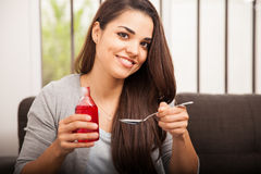 Happy girl drinking cough syrup Stock Photo