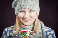 Happy girl drinking hot drink Royalty Free Stock Image
