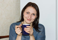 Happy girl drinking hot tea Royalty Free Stock Photos