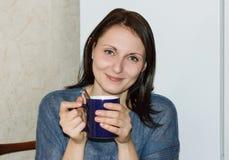 Happy girl drinking hot tea Royalty Free Stock Photos