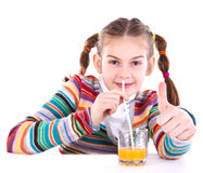 Happy girl drinking juice Royalty Free Stock Photography