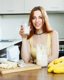Happy girl drinking milk shake Royalty Free Stock Photos
