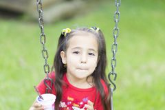 Happy Girl Drinking Milk or Yogurt Stock Images