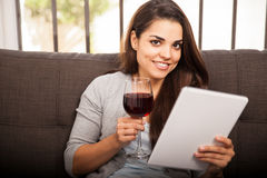 Happy girl drinking wine Stock Images