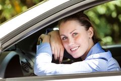 Happy girl driver smiling to you Stock Photography