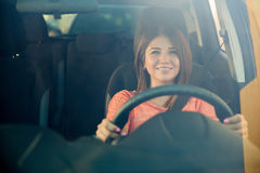Happy girl driving her car Stock Photo