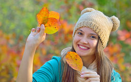 Happy girl with dry leaves stock images