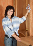 Happy  girl dusting at home Stock Photography