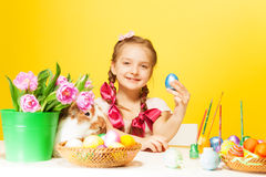 Happy girl with Eastern eggs and cute rabbit Royalty Free Stock Photos
