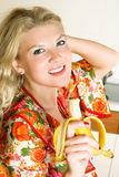 Happy girl eating a banana Royalty Free Stock Photos