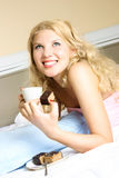 Happy girl eating a cake Stock Image