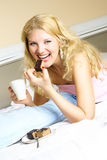 Happy girl eating a cake Royalty Free Stock Photography