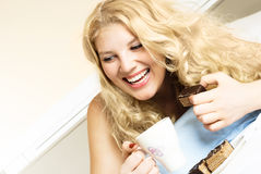 Happy girl eating a cake Royalty Free Stock Images