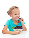 Happy girl eating fresh blackberry Stock Image
