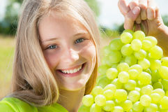 Happy girl eating fresh grapes Royalty Free Stock Photo