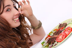 Happy girl eating healthy meal Royalty Free Stock Images