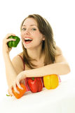Happy girl eating peppers Stock Image