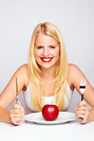 Happy Girl eating an red apple Royalty Free Stock Photos