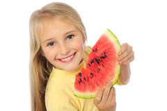 Happy girl eating watermelon Royalty Free Stock Images