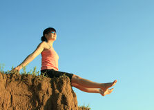 Happy girl on the edge with legs outstretched Stock Photo