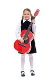 Happy girl with elegant outfit and guitar. Standing, isolated Stock Image