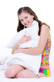 Happy girl  embrace the white pillow Royalty Free Stock Image