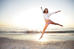 Happy girl enjoy summer day at the beach. Royalty Free Stock Image
