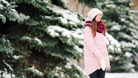 Happy girl enjoy winer and snow weather outdoors on beautiful cold day stock footage