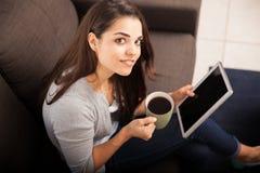 Happy girl enjoying coffee Stock Images