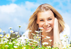 Happy girl enjoying daisy flower field Stock Images