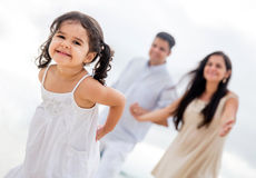 Happy girl with her family Stock Images