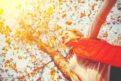 Happy girl enjoying life and freedom in autumn on nature Stock Photo