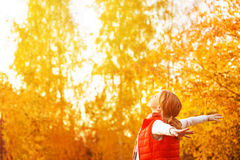 Happy girl enjoying life and freedom in the autumn on nature Stock Photos