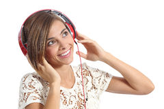 Happy girl enjoying and  listening to the music with headphones Stock Photos