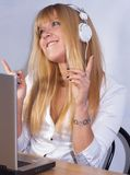 Happy girl enjoying music on headphone Stock Photos