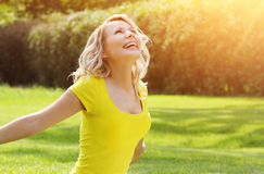 Happy girl enjoying the Nature on green grass. royalty free stock photography