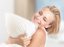 Happy girl enjoying pillow Royalty Free Stock Image