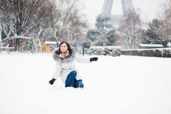 Happy girl enjoying rare snowy day in Paris Stock Photo