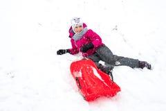 Happy girl enjoying a sleigh ride Stock Photography