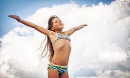 Happy girl enjoying summer outdoors Stock Image