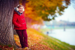 Happy girl enjoys nature in autumn park Stock Photo