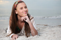Happy girl enjoys summer day at the beach. Royalty Free Stock Photo