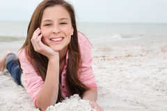 Happy girl enjoys summer day at the beach. Royalty Free Stock Image