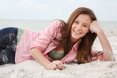 Happy girl enjoys summer day at the beach. Royalty Free Stock Photos