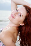 Happy girl enjoys sunny day at the beach. Royalty Free Stock Images