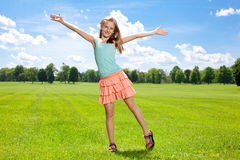 Happy girl enjoys warm summer day outside. Royalty Free Stock Photography