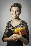 Happy girl with evening dress and present Stock Photography