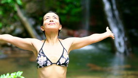Happy girl express freedom by opening arms in tranquil nature Royalty Free Stock Photography