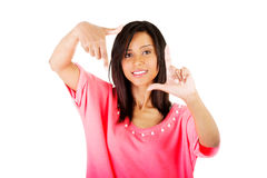 Happy girl with face in frame of palms. Royalty Free Stock Photos